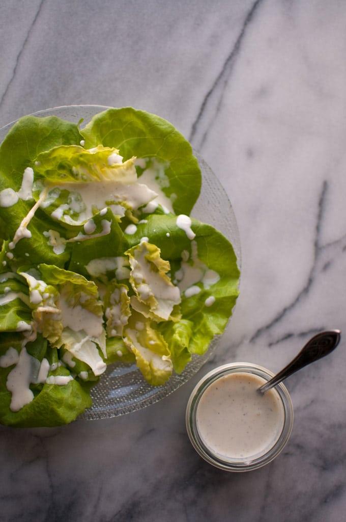 close-up of butter leaf salad with creamy lemon salad dressing