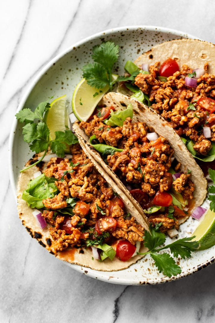 the best ground turkey tacos (3 tacos in a shallow bowl loaded with toppings)