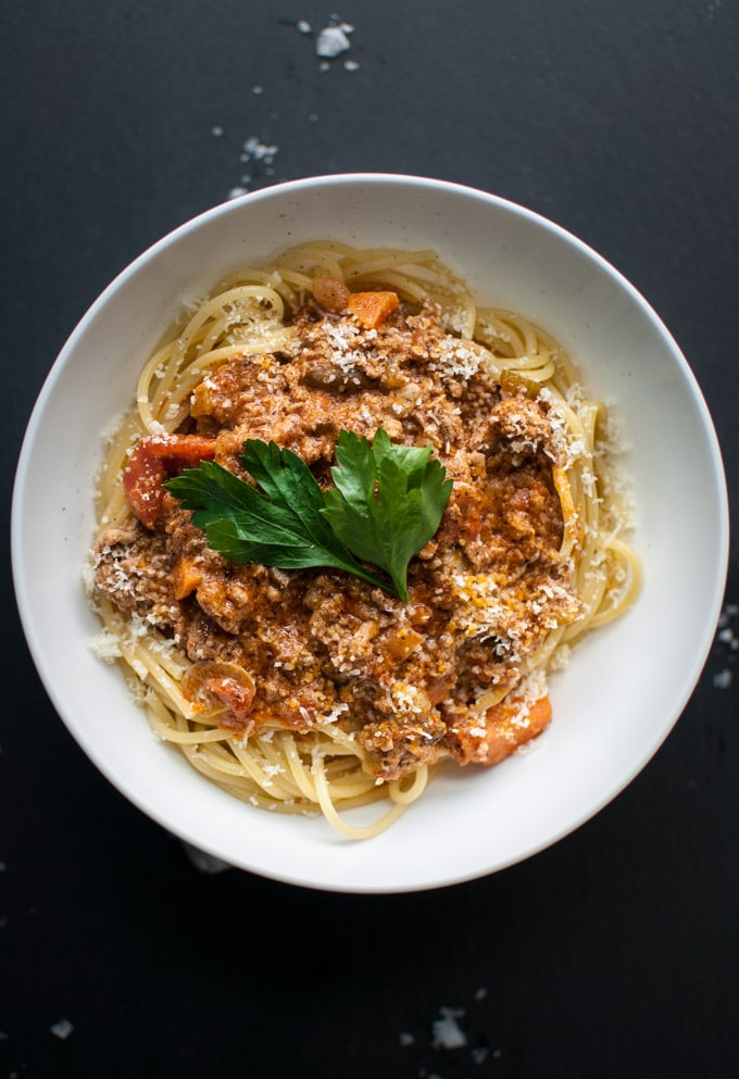 white bowl of meat bolognese spaghetti sauce