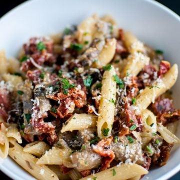 A delicious pasta dish with chorizo, portobello mushrooms, sun-dried tomatoes, and plenty of garlic!