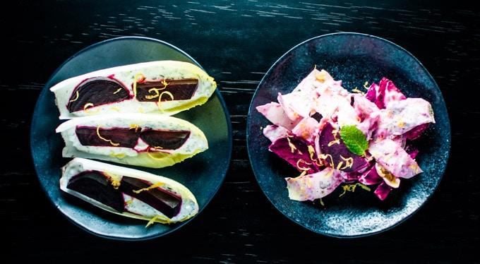 two black bowls with beet, endive, fresh herb, and Greek yogurt salad
