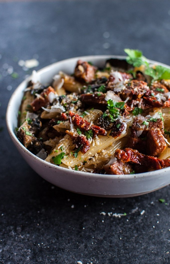 A delicious pasta dish with chorizo, portobello mushrooms, sun-dried tomatoes, and plenty of garlic!