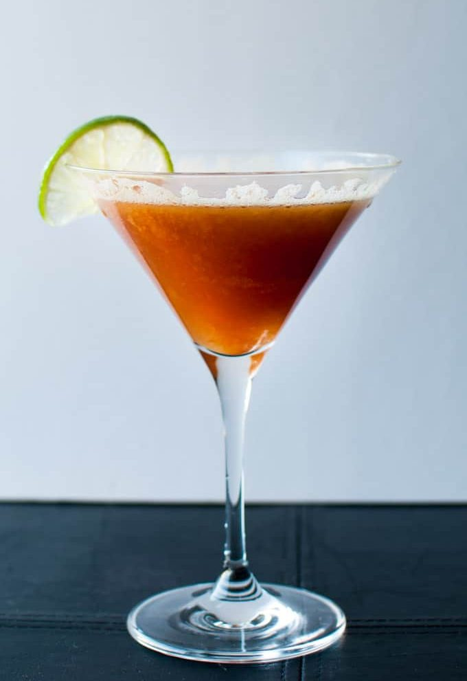 Persimmon Cocktail - a refreshing drink with persimmons, lime, creme de cassis, and champage. - Salt & Lavender
