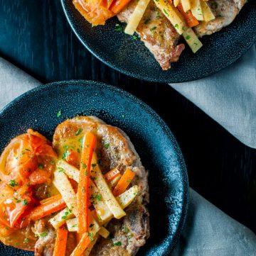 Pork chops in a delicious white wine, carrot, fresh tomato, and celeriac sauce - an elegant dish - Salt & Lavender