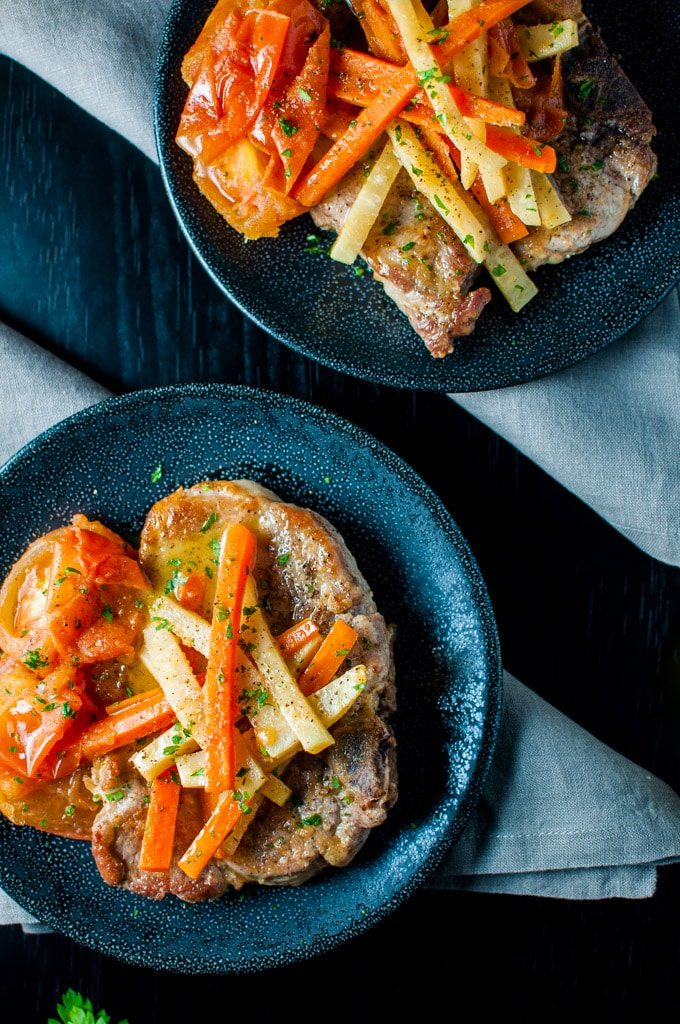 Pork chops in a delicious white wine, carrot, fresh tomato, and celeriac sauce - an elegant dish - Salt & Lavender