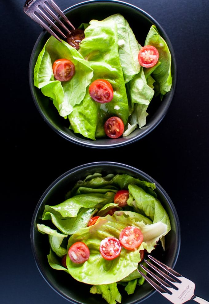 A whisk, garlic, rice vinegar, dijon mustard, shallots, and olive oil create a wonderful emulsion that will make your salad greens taste fantastic.