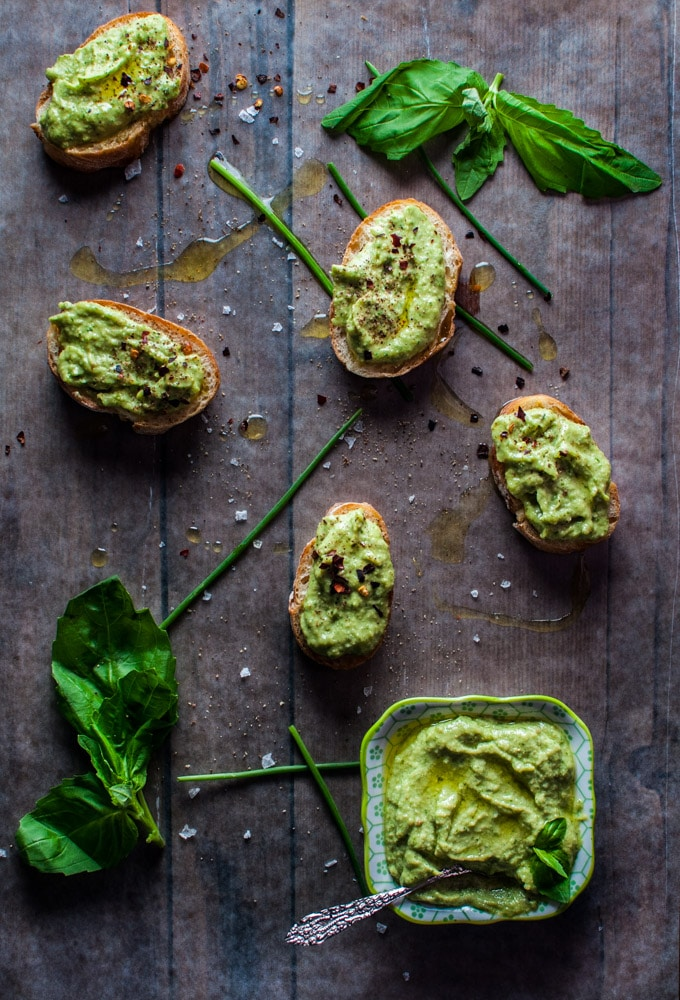 Avocado pesto is a versatile condiment that is great on bread or crackers or with pasta. Avocado, chives, basil, garlic, olive oil, lime, and pine nuts come together to create this tasty spread.