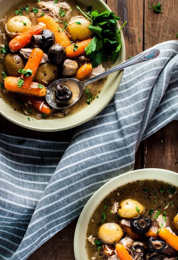 Chuck the ingredients in the slow cooker in the morning and come home to this delicious rustic Crockpot chicken stew! This recipe is healthy, delicious, filling, and will warm you up on a chilly winter day.