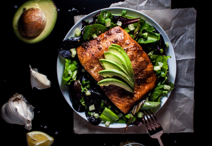 plate with healthy salmon salad with toasted sesame dressing and a fork