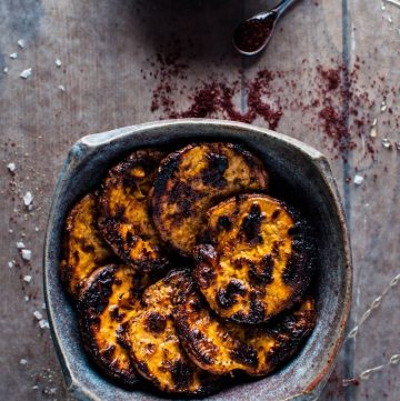 earthenware bowl with honey and sumac charred sweet potato slices