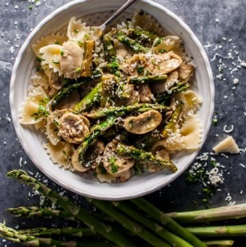 This asparagus and mushroom pasta is a super flavorful meatless dish that comes together quickly and is reminiscent of spring.