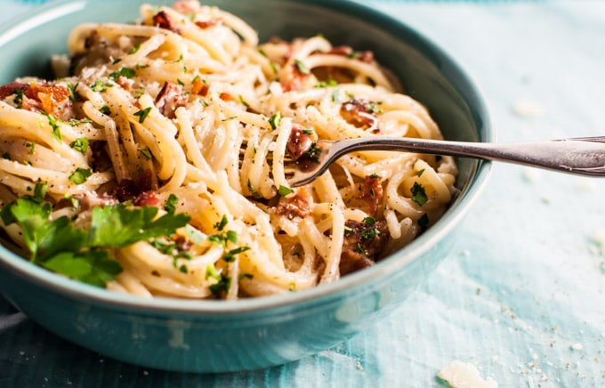 close-up of creamy bacon spaghetti with a fork