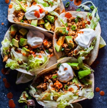 Buffalo chicken tacos - your favorite hot wing sauce is here to kick your tacos up a notch! These tacos only take 25 minutes and are a real crowd pleaser.