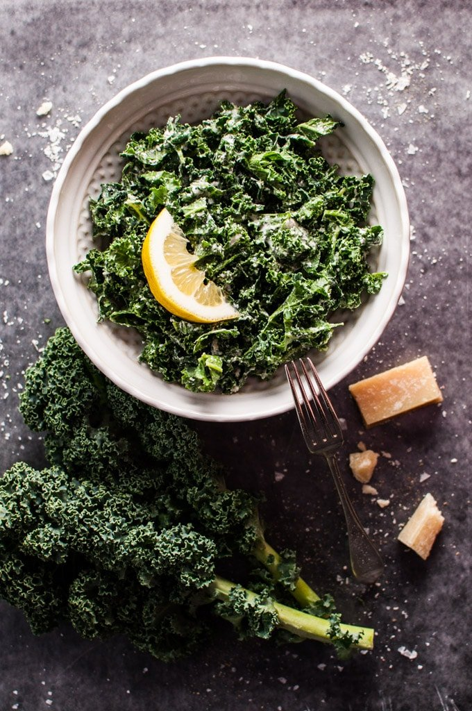 Kale salad with parmesan, lemon, and black truffle oil - you can easily add a gourmet twist to this superfood!