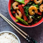 This skinny shrimp stir fry is ready in under half an hour and is packed with flavor and veggies!