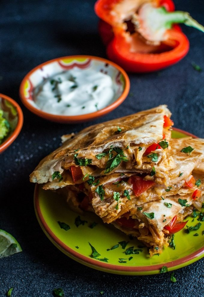 This chicken fajita quesadilla is a quick and easy meal that takes minimal effort and is especially easy if you use leftover or rotisserie chicken! Your favorite fajita fixings are sandwiched in a warm, cheesy pocket of deliciousness.