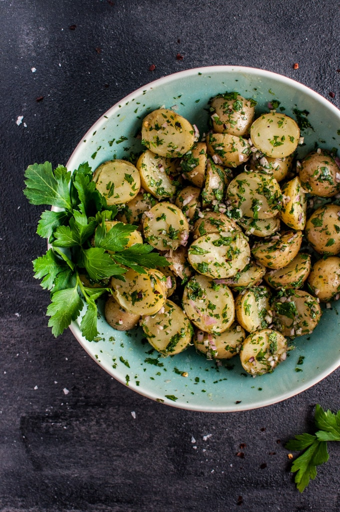 My chimichurri potato salad is packed with flavor from the fresh herbs and garlic! It's the perfect healthy and easy to prepare side dish that's ideal for those who do not like creamy potato salad.