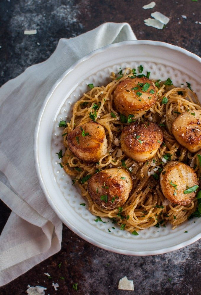 white bowl with chipotle lemon tarragon scallops with angel hair pasta