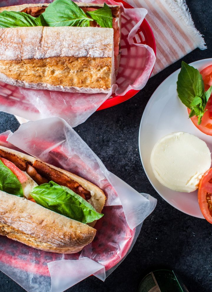 This bacon caprese sandwich is an Italian take on the classic BLT. Fresh mozzarella, basil, juicy tomatoes, and plenty of crispy bacon make this sandwich a winner!