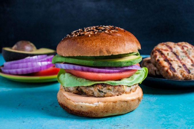 The ultimate chicken burger is juicy, moist, and flavorful! No more dry chicken, and you can have these burgers on the table in half an hour.
