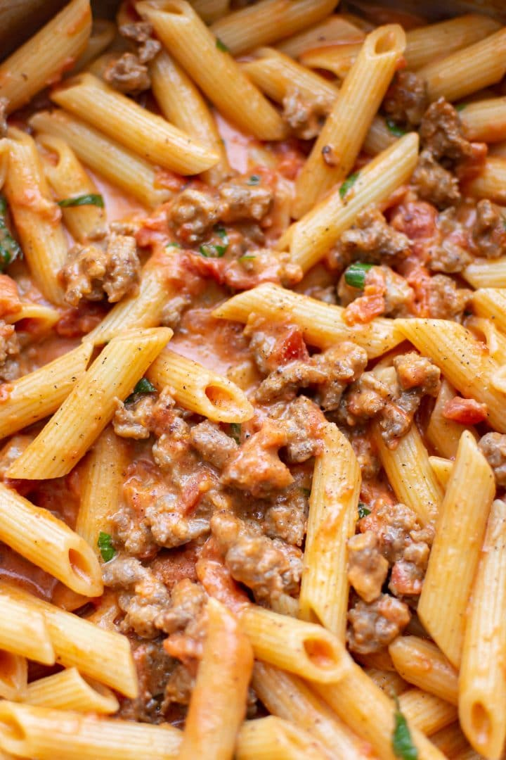 close-up of spicy Italian sausage pasta sauce with penne