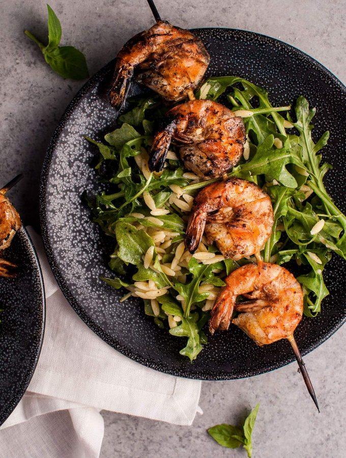 Smoky grilled shrimp, orzo, and fresh arugula tossed with a garlicky lemon dressing makes a delicious light meal or appetizer.