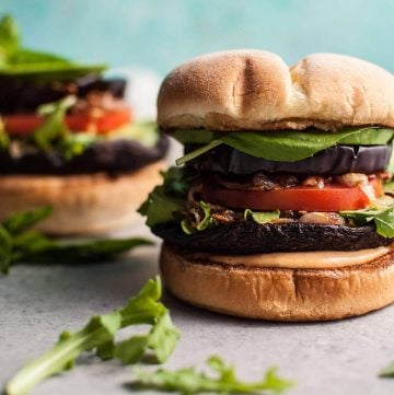 Devour these delicious veggie burgers with grilled portobello mushrooms and eggplant! Fried shallots, more fresh veggies, and a smoky mayo make this a healthier way to get your burger fix.