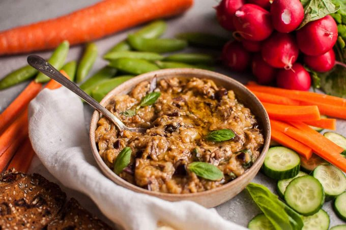 This roasted eggplant dip is easy to make and a fabulous appetizer or snack alongside your favorite veggies, crackers, or other dippables!