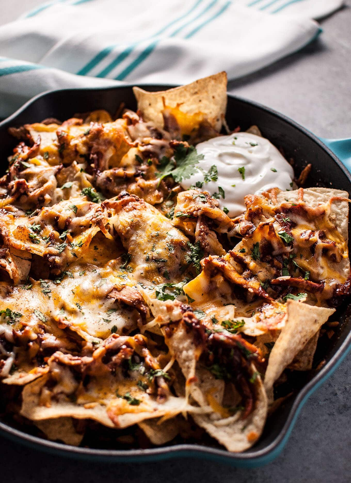 These BBQ chicken skillet nachos are fast, easy, and delicious! The perfect game-day comfort food appetizer. Ready in only 25 minutes!