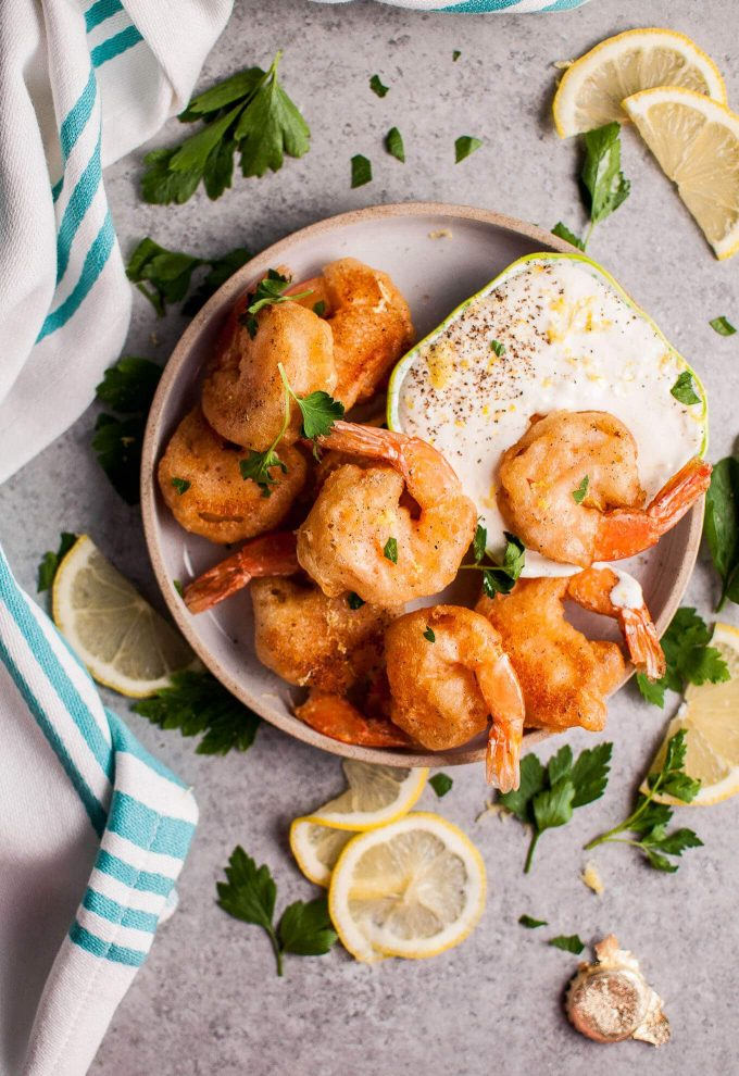 These crispy beer battered fried shrimp make an awesome appetizer! The dipping sauce is fresh and zesty.