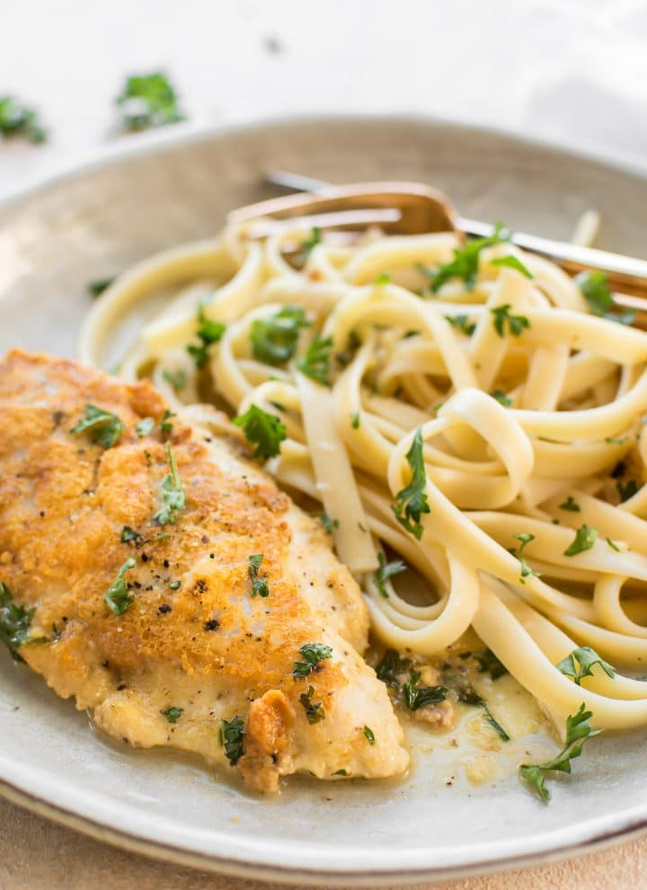 This easy Chicken Francese recipe is made with tender parmesan-crusted chicken breasts. The lemon butter sauce can be made with no wine, and it goes wonderfully with pasta or mashed potatoes!