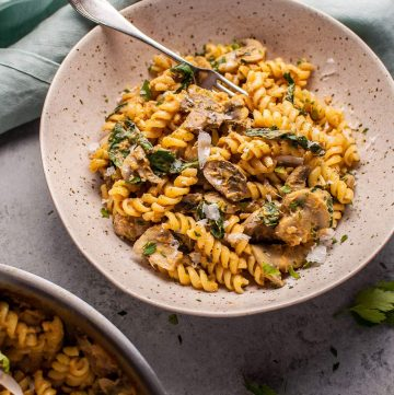 Pumpkin, mushroom, and spinach pasta is a healthy, comforting, and filling vegetarian fall dish.