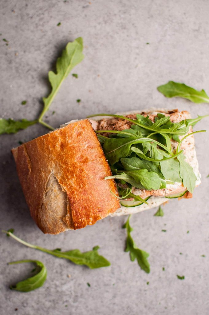 This easy baked salmon sandwich with zesty lemon mayo and arugula is a fast and delicious lunch idea! Ready in 20 minutes.