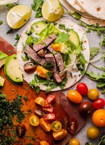 Summer steak tacos are easy, healthy, and full of flavor! Fresh oregano, parsley, cilantro, lime, and arugula kick up the taste in this 20 minute meal.