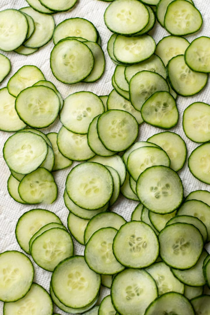 cucumber slices on paper towel for creamy cucumber salad