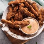 Crispy battered fried pickles with deliciously tangy remoulade sauce makes a fantastic appetizer!