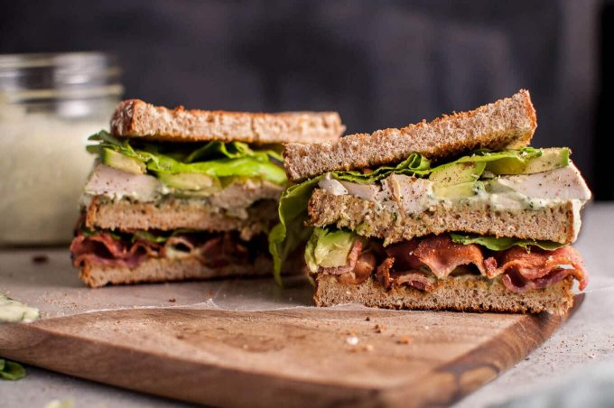 This Green Goddess chicken sandwich is a delicious way to use up leftover chicken (or leftover turkey!). Homemade Green Goddess dressing, smoky bacon, avocado, and crisp salad greens complete this tasty sandwich.