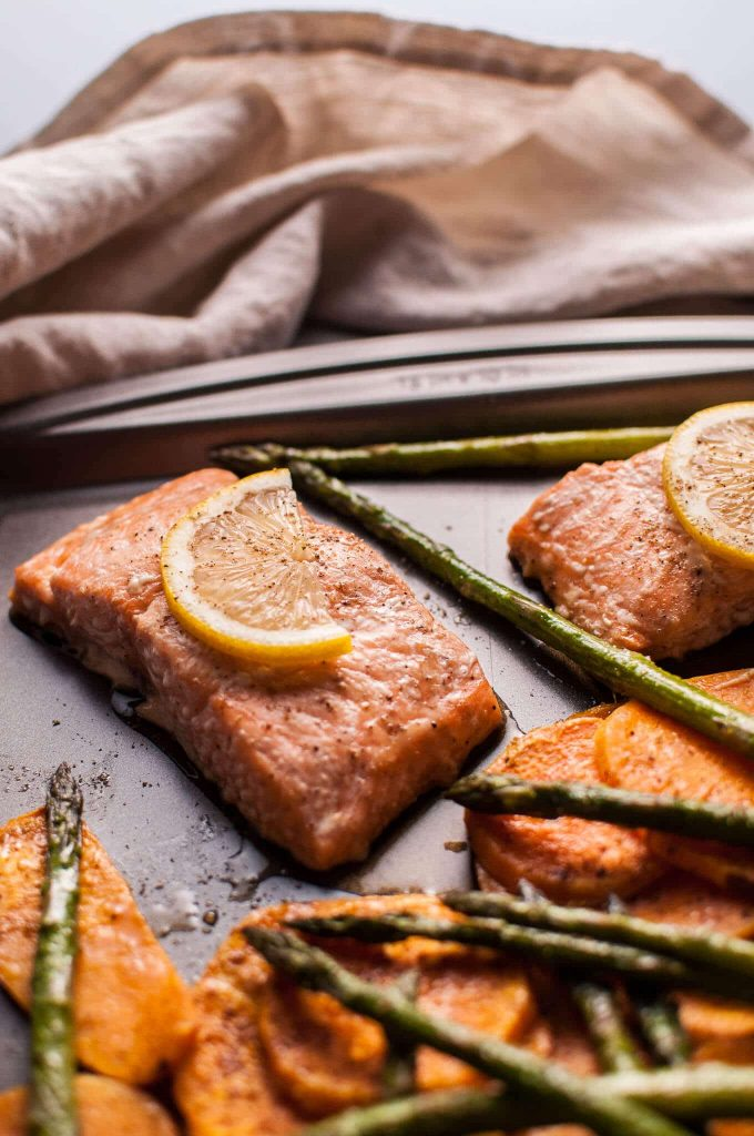 My maple salmon sheet pan dinner with sweet potatoes and asparagus is an easy, fast, delicious, and comforting fall meal!