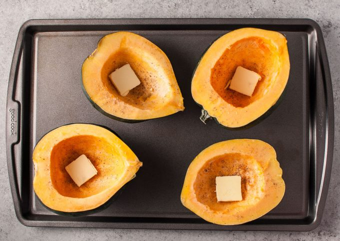 Sausage and parmesan stuffed acorn squash makes a cozy and delicious cold weather meal!