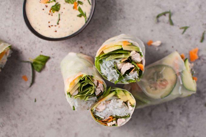 close-up of three leftover chicken salad rolls beside bowl of tarragon miso dip