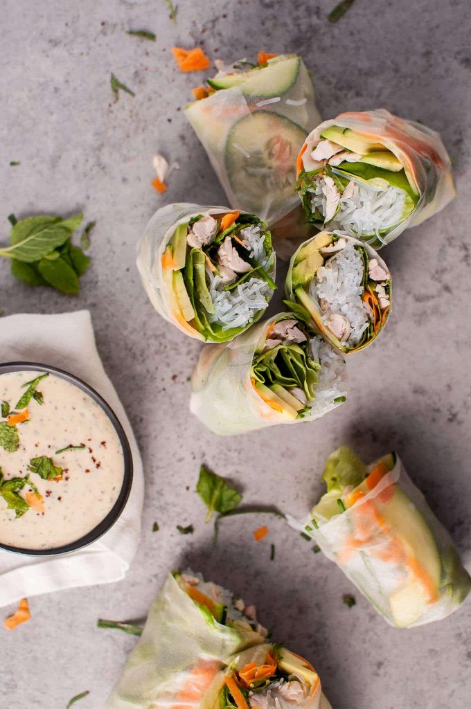 several chicken salad rolls with miso tarragon dipping sauce in a bowl
