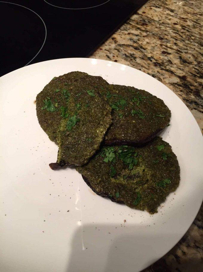 portobello mushrooms doused in pesto and parsley garnish but looking bad