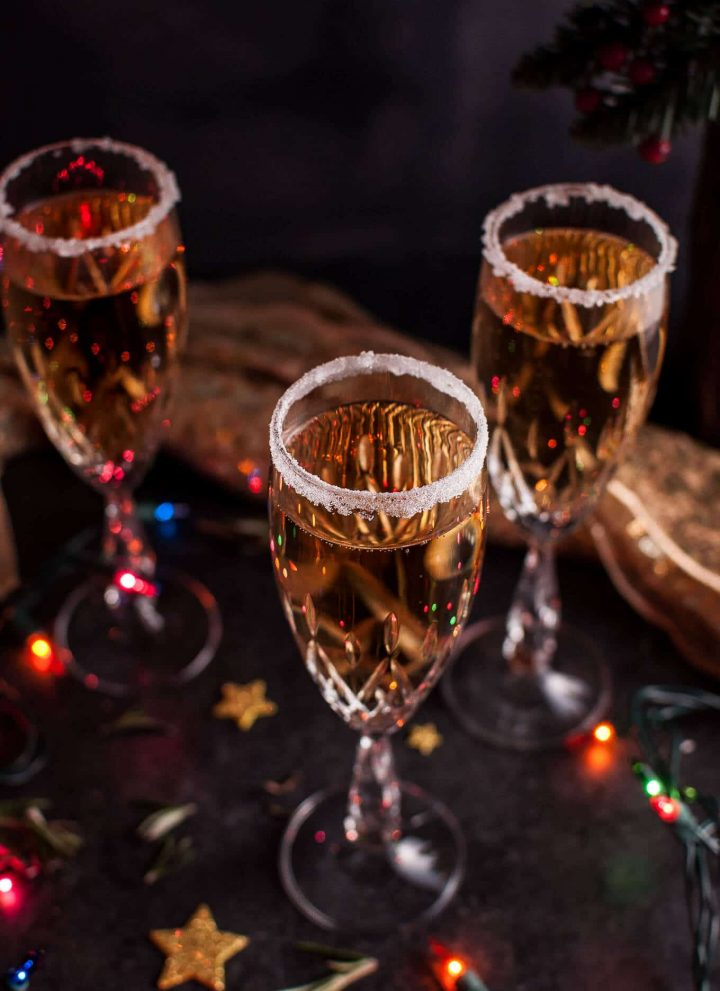 This Christmas pear champagne cocktail is simple, different, and luxe! The perfect cocktail for the holidays or to ring in the New Year. Poire Williams is added to champagne or sparkling wine to create this delicious drink.