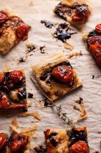 My roasted tomato puff pastry appetizer with a balsamic drizzle is a flavorful vegetarian appetizer that will please a crowd!