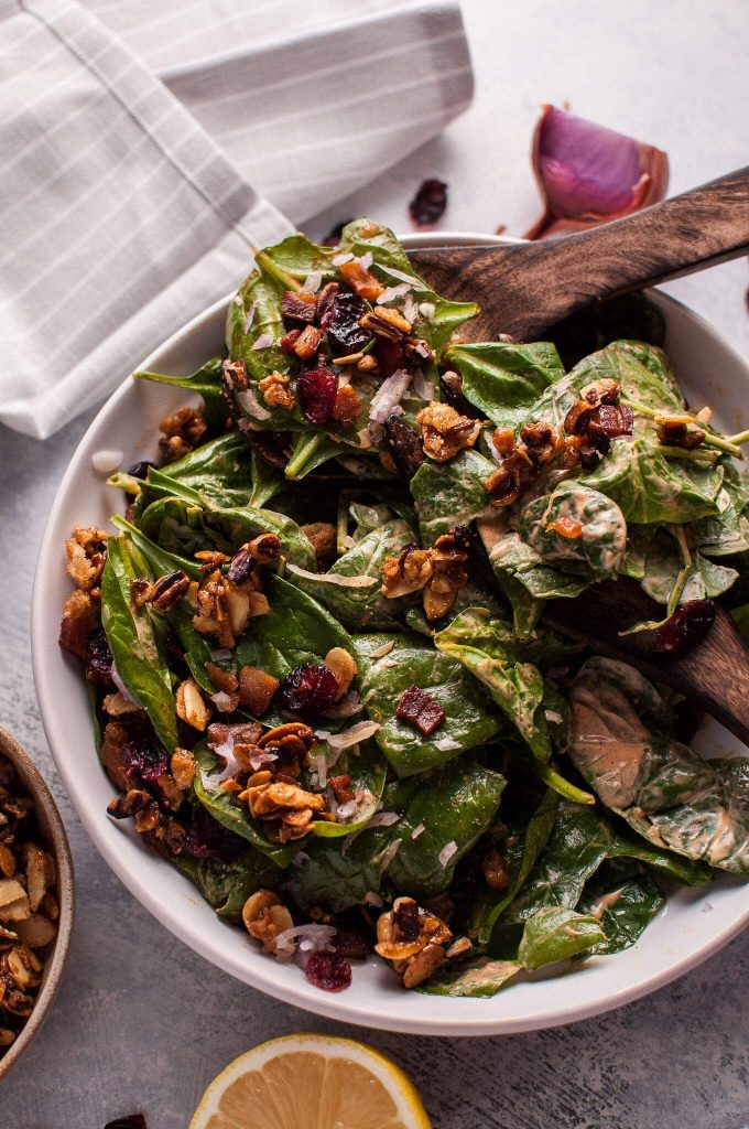 Spinach salad with crispy pancetta and candied nuts is a hearty winter salad that will satisfy your sweet and salty cravings.