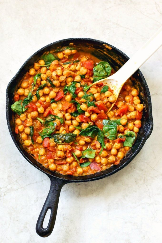 cast iron skillet with chickpea and spinach curry