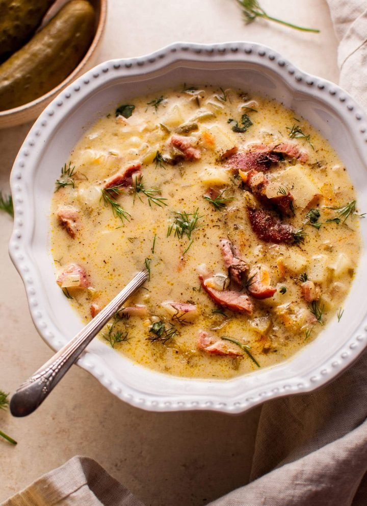 Polish dill pickle soup with smoked ham is a hearty, savory, creamy, and comforting dish. A big pot of it can be on your table in only 45 minutes!