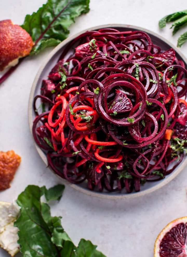 bowl of spiralized raw beet salad with blood oranges