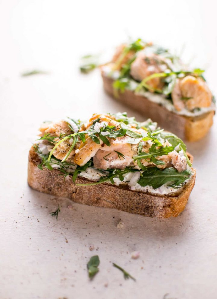 Baked salmon, lemon, crusty bread, fresh dill, Greek yogurt, shallot, and arugula make this salmon tartine one delicious open-faced sandwich! Ready in 20 minutes.