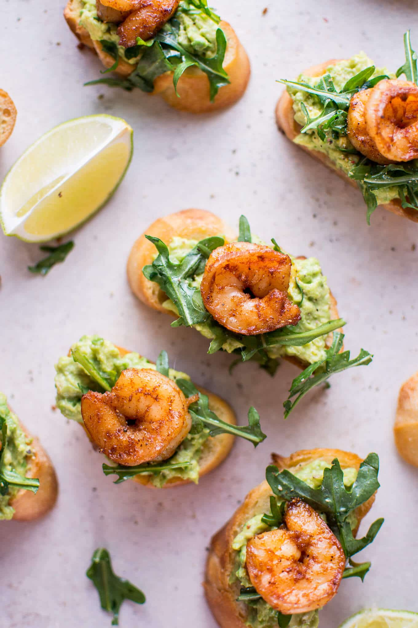 Garlic shrimp and avocado crostini are a fresh and delicious bite-size appetizer that will be a hit at any gathering or party!